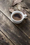 Coffee cup on the autumn fall leaves Stock Photography