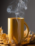 Coffee cup and autumn leaves on a wooden table. Royalty Free Stock Images
