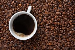 Coffee cup on background of beans Royalty Free Stock Photos