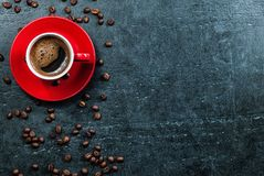 Coffee cup background with coffee beans top view. Stock Photo
