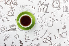 Coffee cup on background of business strategy.  Royalty Free Stock Photography
