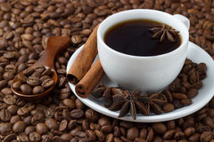 Coffee in a cup on the background of coffee beans.  Royalty Free Stock Photos