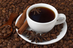 Coffee in a cup on the background of coffee beans.  Royalty Free Stock Images
