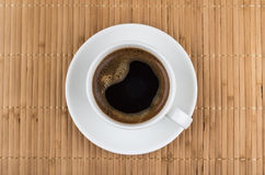 Coffee cup on bamboo mat Stock Image