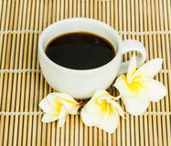 Coffee cup on bamboo wrap Royalty Free Stock Photos