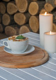 Coffee cup on bar table and romantic candles closeup Royalty Free Stock Photos