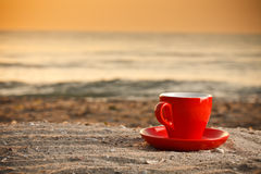 Coffee cup on beach Royalty Free Stock Photo