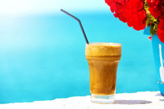 Coffee cup at the beach royalty free stock images
