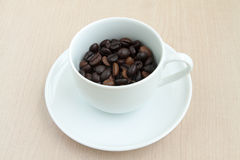Coffee cup with bean Royalty Free Stock Image