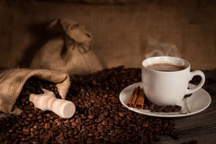 Coffee cup. A cup of coffee with coffee bean as background Royalty Free Stock Photo