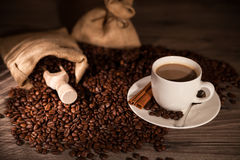 Coffee cup. A cup of coffee with coffee bean as background Stock Photos