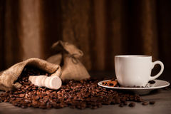 Coffee cup. A cup of coffee with coffee bean as background Royalty Free Stock Photography