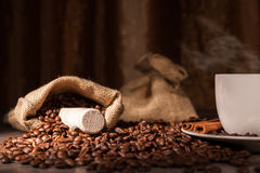 Coffee cup. A cup of coffee with coffee bean as background Royalty Free Stock Photos