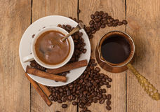 Coffee cup. A cup of  coffee bean and coffee beans on background Stock Photography