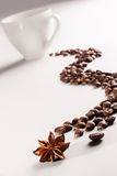 Coffee cup and bean path with aniseed Stock Photos
