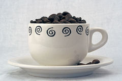 Coffee cup with beans. In close up Stock Photo