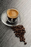 Coffee cup with beans Stock Images