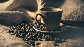 Coffee cup and coffee beans.  stock footage