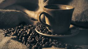 Coffee cup and coffee beans.  stock video footage