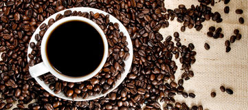 Coffee cup and beans. Coffe cup over coffee beans Stock Images