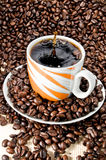 Coffee cup and beans. Coffee cup splash and coffee beans Stock Photography