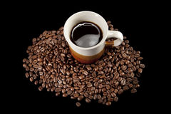 Coffee cup and beans. On black background Royalty Free Stock Image