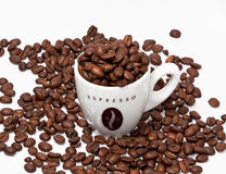 Coffee cup and beans. Espresso cup and coffee beans on white background Stock Photo