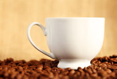 Coffee cup on beans Royalty Free Stock Photos
