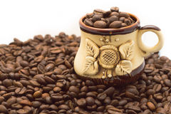 Coffee cup on the beans Stock Images