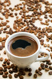 Coffee cup and beans. White cup of coffee and beans Royalty Free Stock Photography