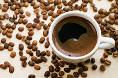 Coffee cup and beans. White cup of coffee and beans Stock Photo