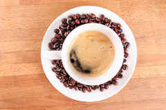 Coffee in a cup with beans Stock Photography