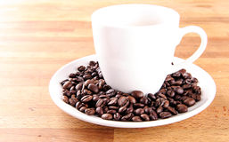 Coffee in a cup with beans Stock Photos