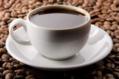 Coffee Cup and The Beans Stock Photography
