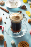 Coffee cup and beans at blue background Stock Photography