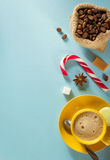 Coffee cup and beans at blue background Stock Image