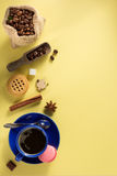 Coffee cup and beans at blue paper Stock Image