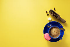 Coffee cup and beans at blue paper Stock Photography