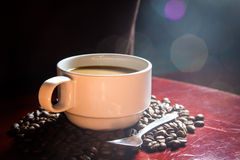 Coffee cup. And beans bokeh backgrounds Royalty Free Stock Photos