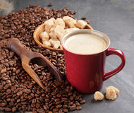 Coffee cup, beans and brown sugar Stock Images