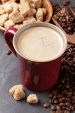 Coffee cup, beans and brown sugar Stock Image