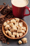 Coffee cup, beans and brown sugar Royalty Free Stock Image