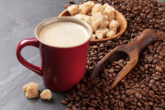 Coffee cup, beans and brown sugar Royalty Free Stock Photos