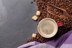 Coffee cup, beans and brown sugar on stone table Royalty Free Stock Photography