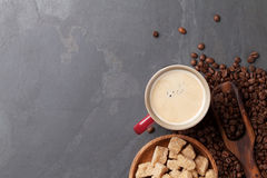 Coffee cup, beans and brown sugar Stock Photos