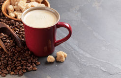 Coffee cup, beans and brown sugar Royalty Free Stock Photography