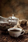 Coffee cup, beans and canvas sack Stock Photo