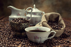 Coffee cup, beans and canvas sack Stock Image