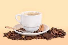 Coffee cup with beans. Coffee cup with coffee beans, chocolate and cinnamon stock photo