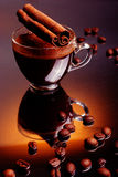 Coffee cup with beans and cinnamon Royalty Free Stock Photography